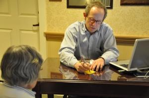 Dr. Sloan evaluating a patient.
